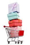 Shopping cart and giftboxes. On white Royalty Free Stock Image