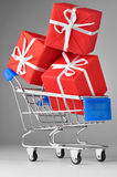 Shopping cart with gifts Royalty Free Stock Photography