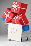Shopping cart with gifts and heart royalty free stock photos