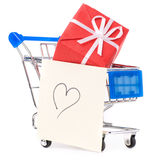 Shopping cart with gifts and heart Stock Images