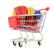 Shopping cart with gifts new year and Christmas gifts Stock Images