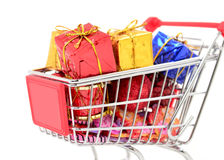 Shopping cart with gifts new year and Christmas gifts Stock Image