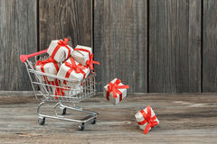 Shopping cart with gifts Stock Image
