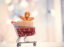 Shopping cart and gingerbread man Royalty Free Stock Images