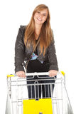 Shopping cart and girl Royalty Free Stock Photography
