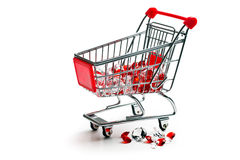 Shopping cart with glass stones. On white background Royalty Free Stock Photography