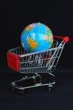 Shopping cart and globe. On black background Stock Images