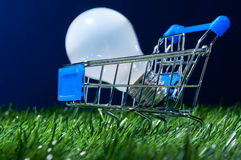 Shopping cart in grass stock photography