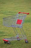 Shopping cart in the grass Royalty Free Stock Photos