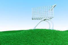 Shopping Cart on Green Hills Stock Photography