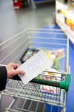 Shopping cart and groceries Stock Photos