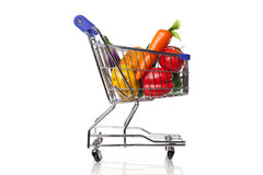 Shopping cart with groceries Royalty Free Stock Photos
