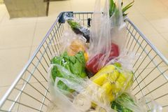Shopping cart with grocery items at supermarket Royalty Free Stock Photography
