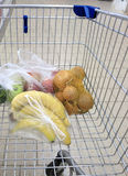Shopping cart with grocery at supermarket Stock Photography