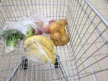 Shopping cart with grocery at supermarket Royalty Free Stock Photography