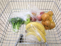 Shopping cart with grocery at supermarket Stock Photo