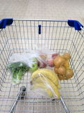 Shopping cart with grocery at supermarket Royalty Free Stock Photos