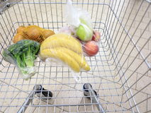 Shopping cart with grocery at supermarket Royalty Free Stock Images