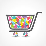 Shopping cart with group of colorful leaf Stock Photos