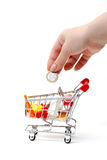 Shopping Cart with Hand and Coin Stock Photography
