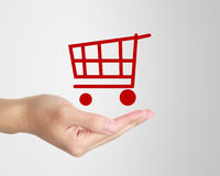 Shopping Cart. Hand holding a shopping cart on gradually varied background Stock Photography