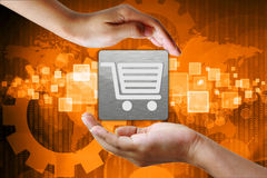 Shopping cart in hand Royalty Free Stock Photo