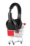 Shopping cart with headphones Royalty Free Stock Image