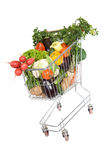 Shopping cart with healthy vegetables Royalty Free Stock Photos