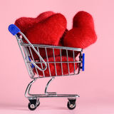 Shopping cart with hearts Stock Image