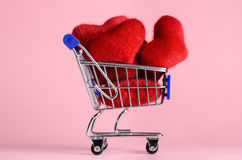 Shopping cart with hearts royalty free stock images