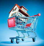 Shopping cart and house Royalty Free Stock Photography