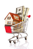 Shopping cart and house Royalty Free Stock Photos