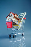 Shopping cart and house Royalty Free Stock Image