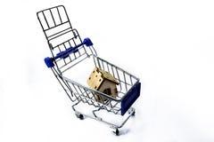 Shopping cart with house Stock Photos