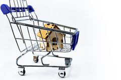 Shopping cart with house Stock Images
