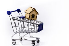 Shopping cart with house Royalty Free Stock Images