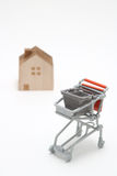 Shopping cart and house on white background. Buying new house, Stock Photography