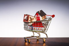 Shopping Cart with houses Royalty Free Stock Image