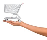Shopping cart in humans hand. On isolated white background Royalty Free Stock Photography