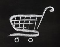 Shopping cart icon. Hand drawn by chalk over blackboard Royalty Free Stock Photography