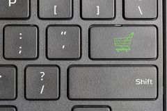 Shopping cart icon on computer keyboard. Green shopping cart key on computer keyboard , online shopping concept Royalty Free Stock Photos