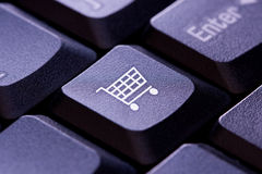 Shopping cart icon on a computer keyboard key. Close up Royalty Free Stock Photo
