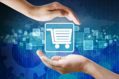 Shopping cart icon in hand Royalty Free Stock Photo