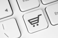 Shopping cart icon on keyboard key Royalty Free Stock Photos