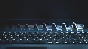 Shopping cart icon on laptop. Internet shopping stock photos