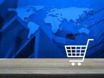 Shopping cart icon on wooden table over world map and city tower. Background, Shop online concept, Elements of this image furnished by NASA Royalty Free Stock Photos