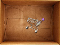 Shopping cart inside of the package box Stock Photos