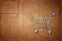 Shopping cart inside of the package box Stock Images
