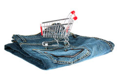Shopping Cart with Jeans Royalty Free Stock Photos