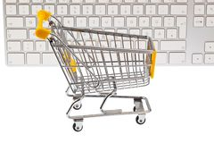 A shopping cart and keyboard Stock Photos